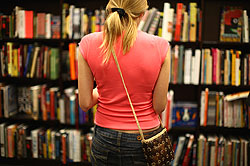 lady browsing bookshelf