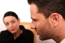 Man talking to female counsellor